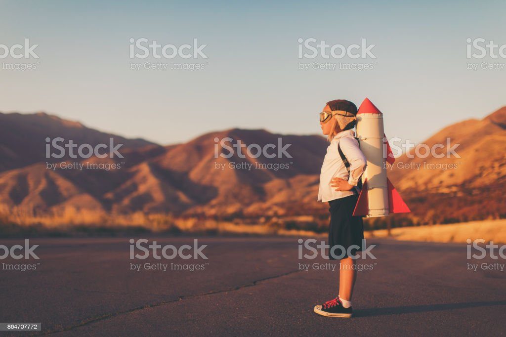 Young Business Girl with Rocket Pack stock photo