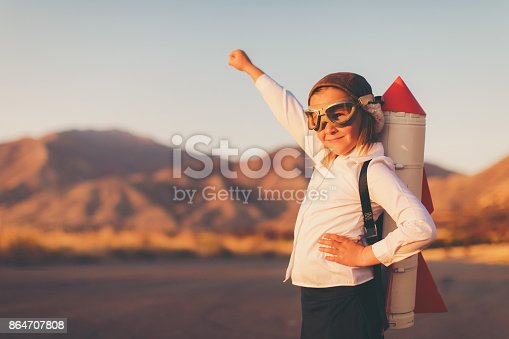 istock Young Business Girl with Rocket Pack 864707808