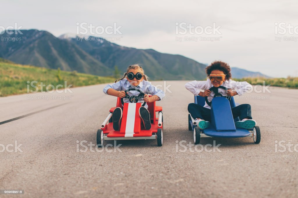 Young Business Girls Race Go Carts stock photo