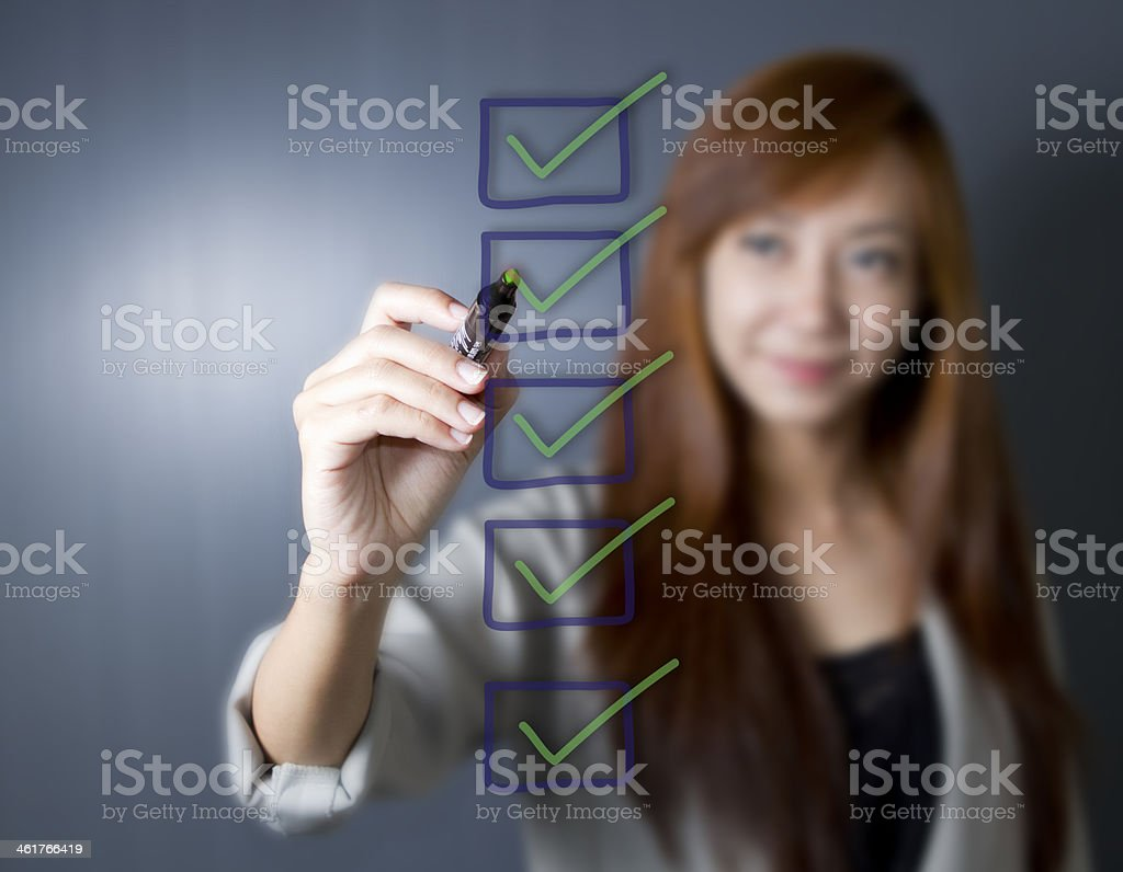 Young business hand with pen mark the check boxes. stock photo