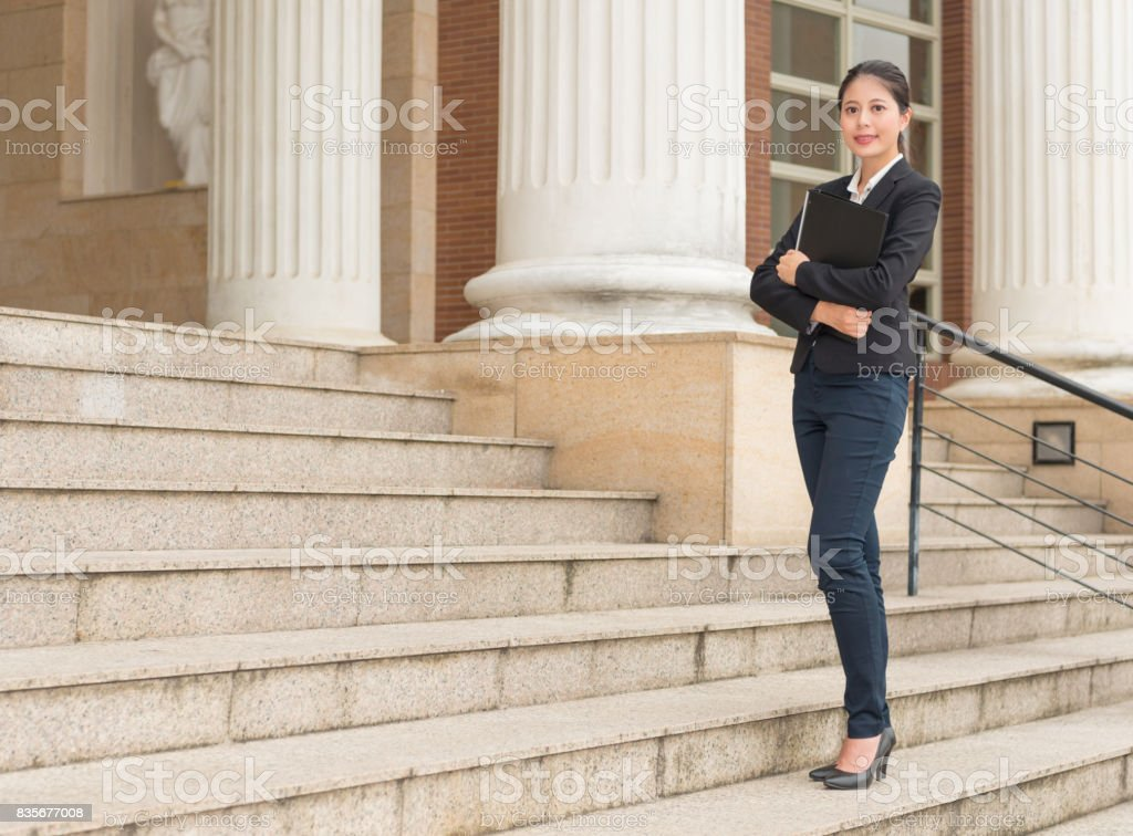 young business lawyer standing on the court stock photo