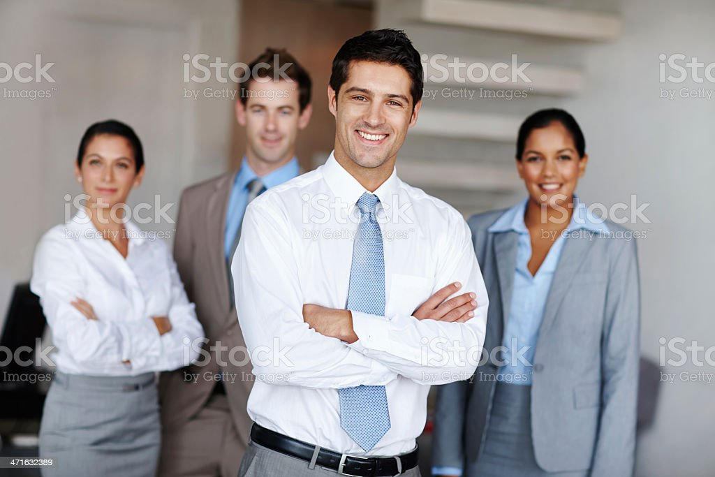 Young business leader with his team royalty-free stock photo
