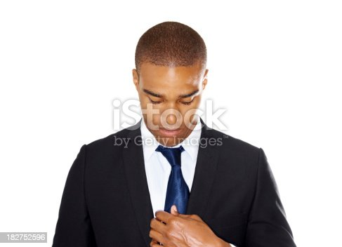 istock Young business man adjusting his tie isolated against white 182752596