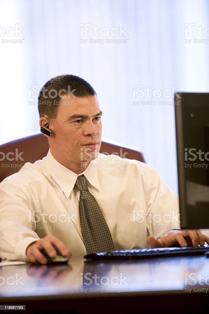 Young Business Man At His Desk royalty-free stock photo