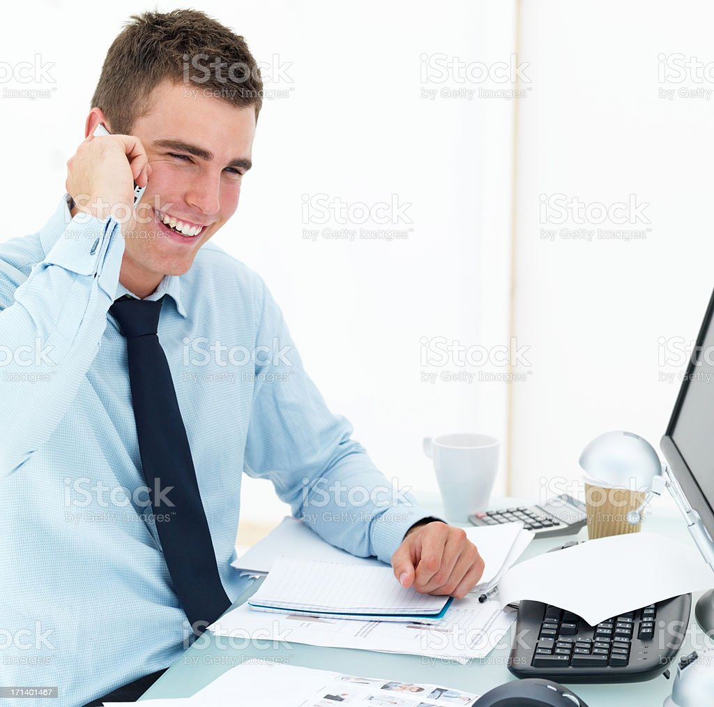 Young business man at office desk using cellphone royalty-free stock photo