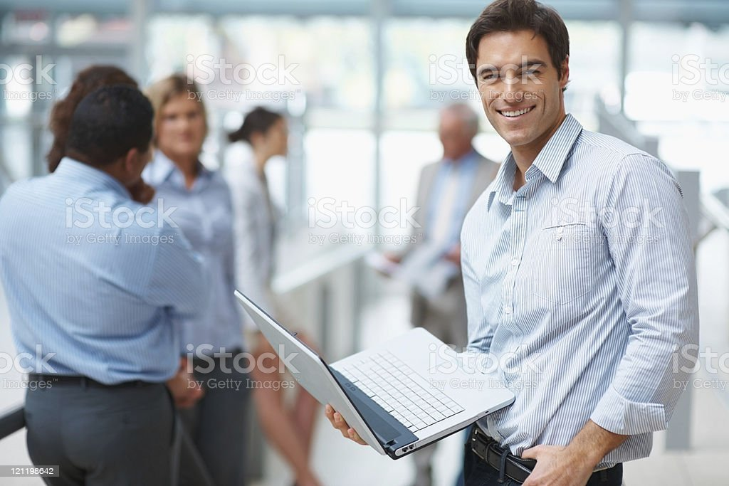 Young business man browsing the internet at office royalty-free stock photo