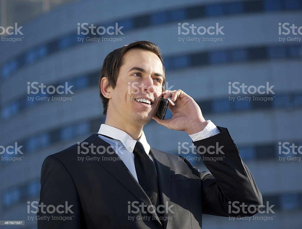 Young business man calling by mobile phone outdoors royalty-free stock photo