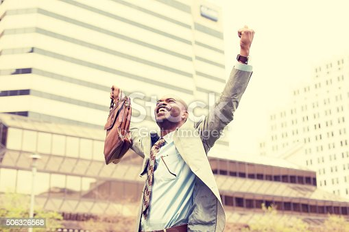 istock Young business man celebrates freedom success arms raised 506326568