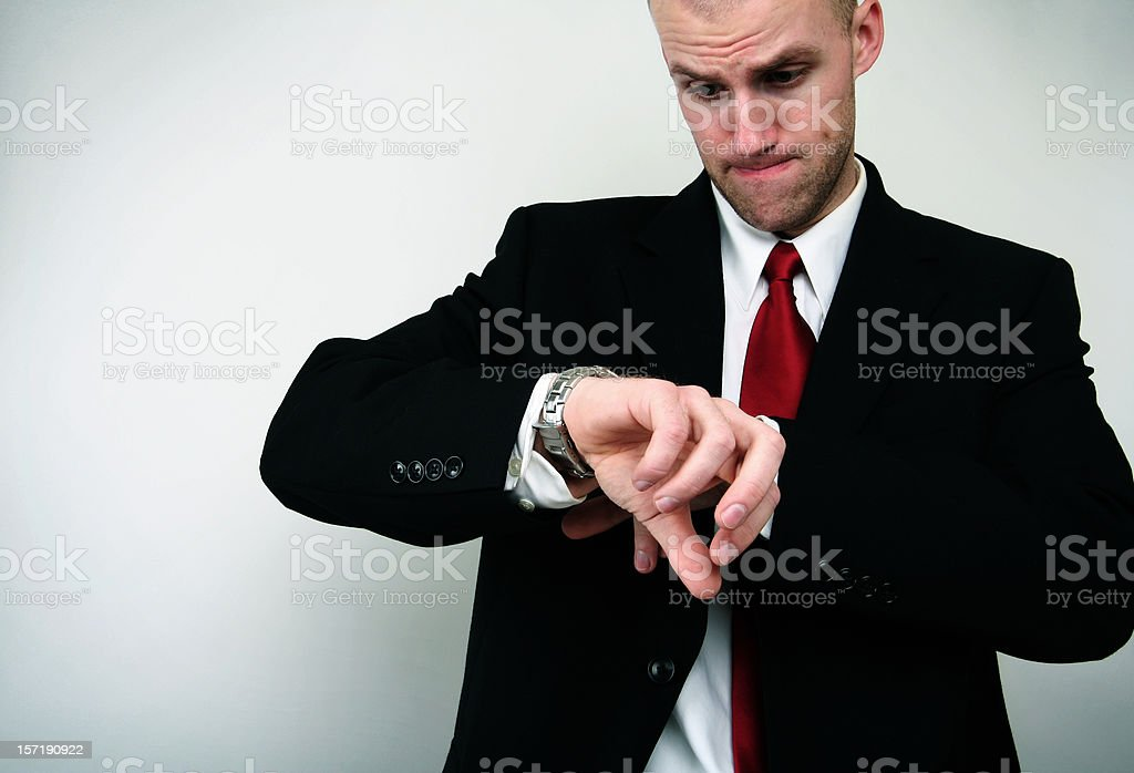 Young Business Man Checks His Watch royalty-free stock photo