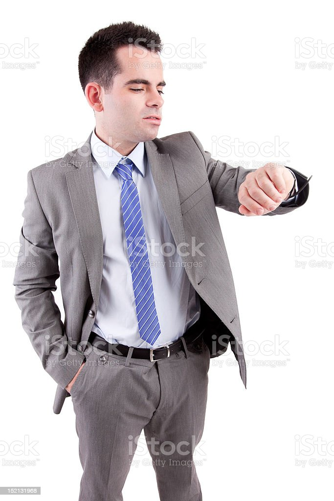 Young business man consulting his watch stock photo