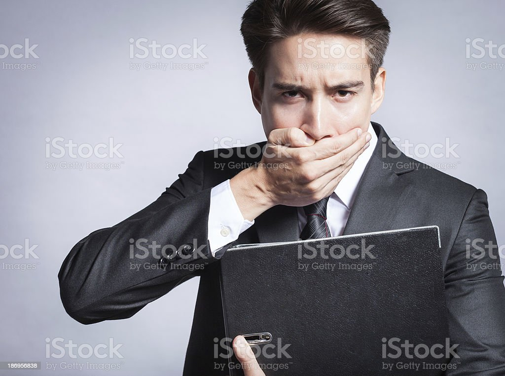 Young business man covering his mouth royalty-free stock photo
