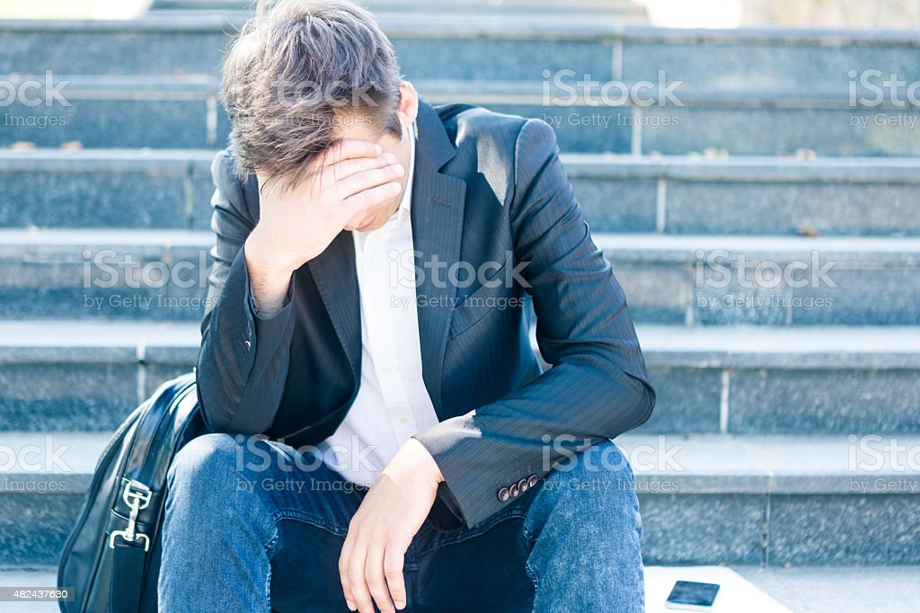 Young business man crying stock photo
