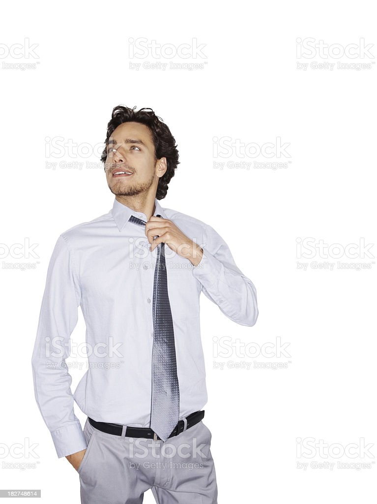 Young business man easing his tie , isolated on white royalty-free stock photo
