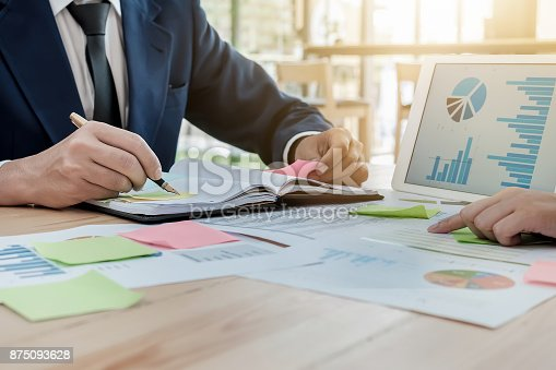 istock young business man hoding pen point notebook with partner using 875093628
