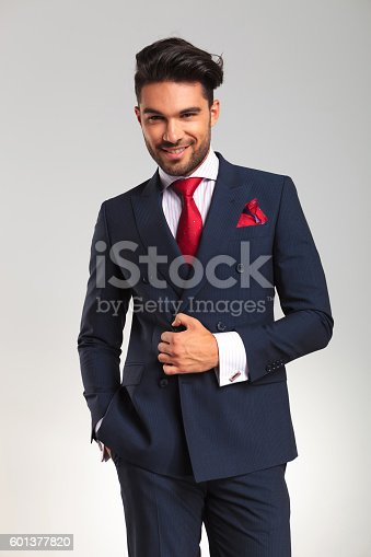 istock young business man in double breasted suit smiling 601377820