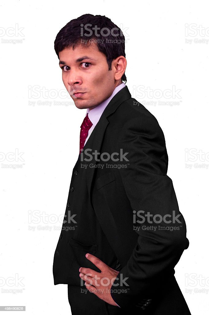 Young business man looking sideways in anger. stock photo