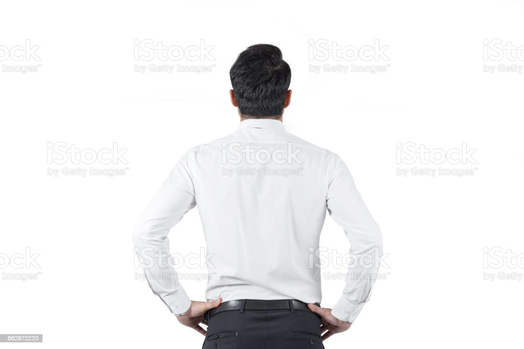 Young business man looking up stock photo