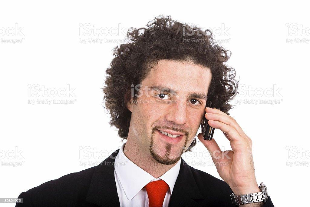 Молодой Деловой человек, менеджер, говорить на мобильный телефон и улыбку Стоковые фото Стоковая фотография