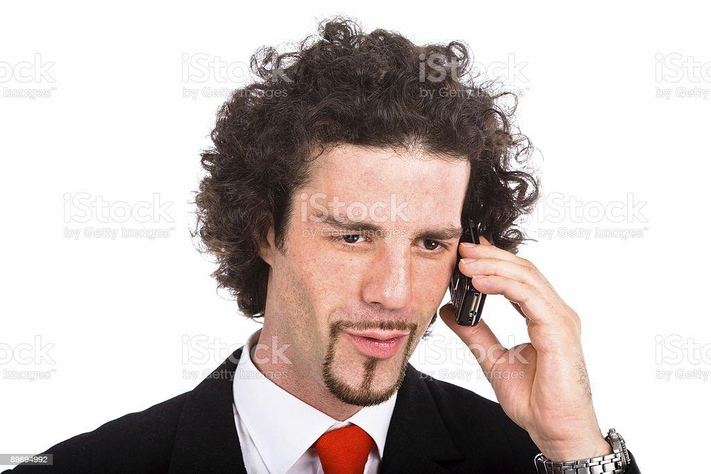 Joven hombre de negocios hablando por teléfono móvil foto de stock libre de derechos