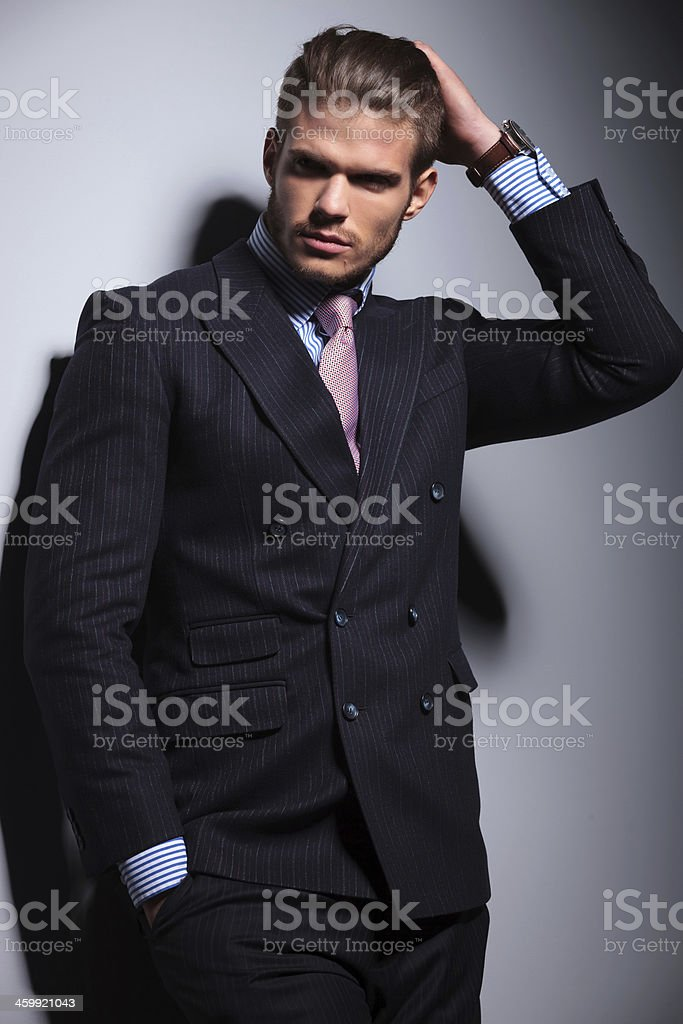 young business man on gray background royalty-free stock photo