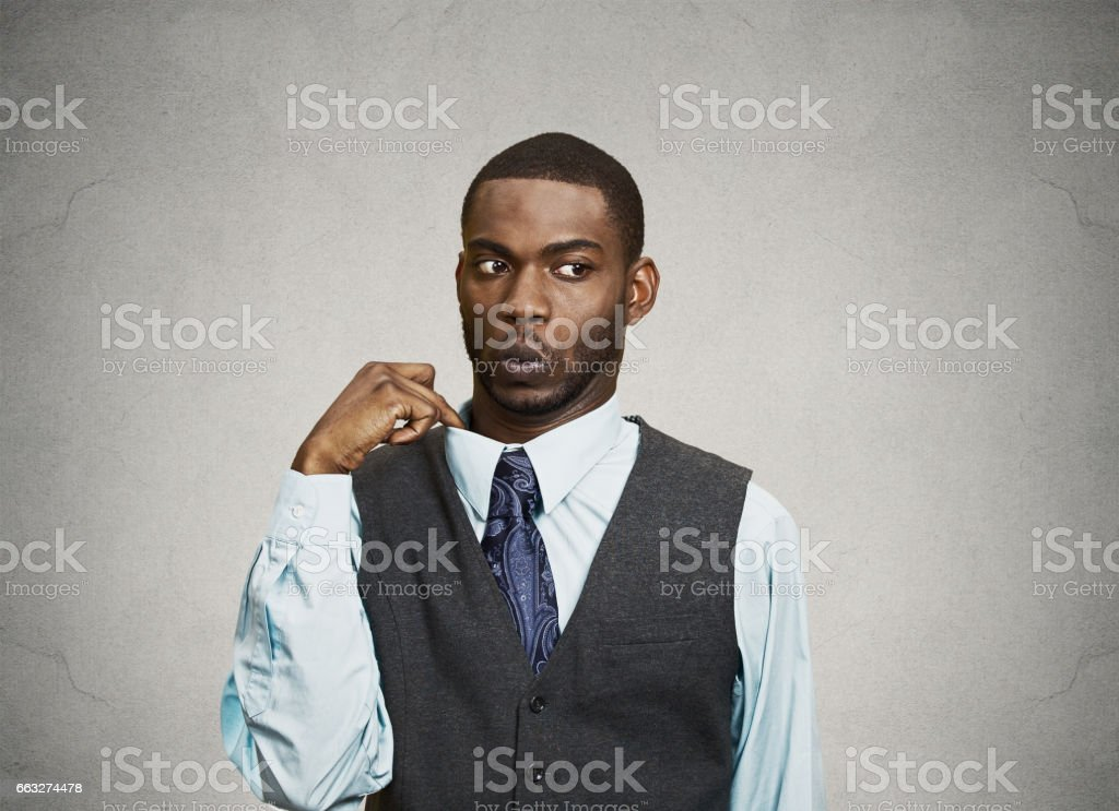 young business Man opening shirt to vent stock photo