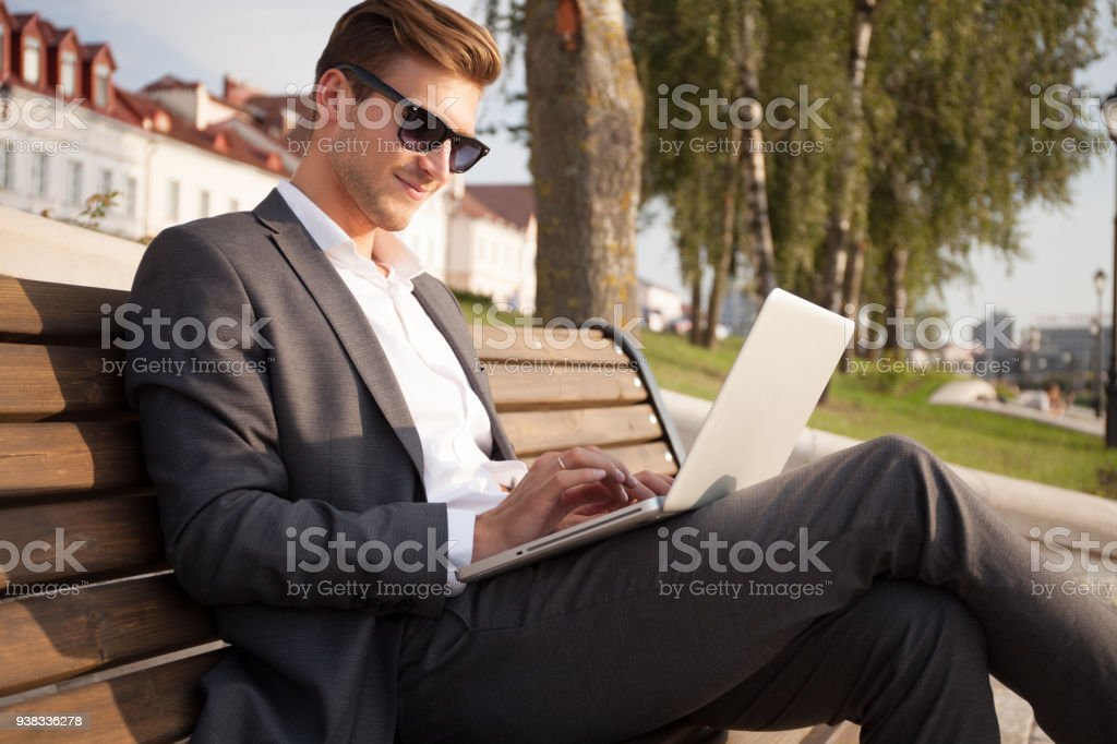 Young business man outdoors work occupation lifestyle. stock photo