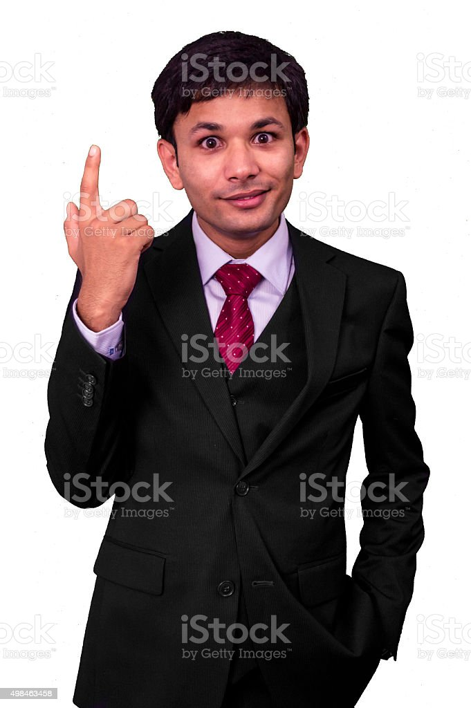 Young business man pointing finger up stock photo