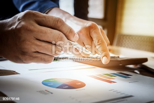 942382022istockphoto Young business man pointing graph chart with partner   for analyze, plan, improve, improve their marketing. 926479146