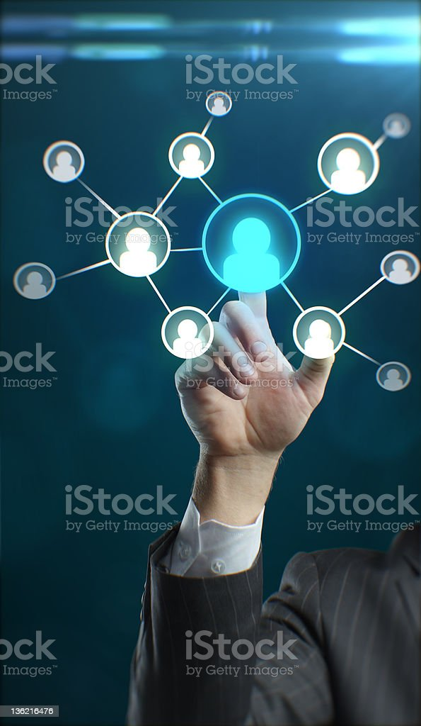 Young business man pressing a touchscreen Social Network button royalty-free stock photo