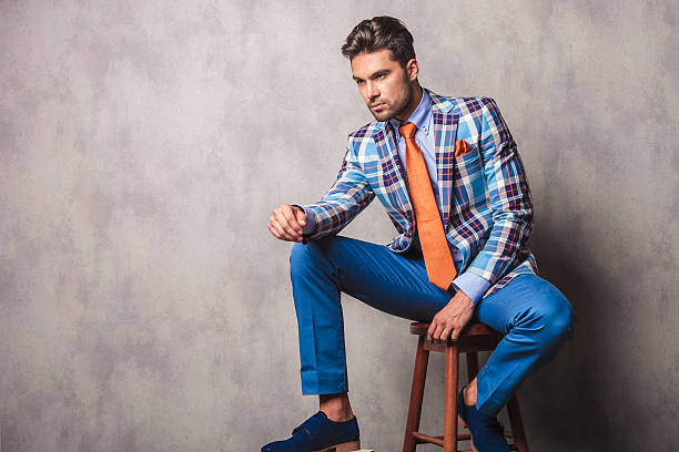 young business man sitting on a chair - preppy fashion stock photos and pictures