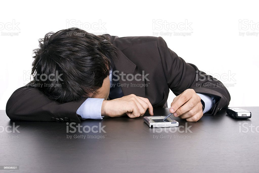 young business man sleeping on the desk royalty-free stock photo