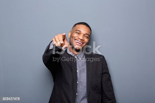 825083570 istock photo Young business man smiling and pointing finger 523427475