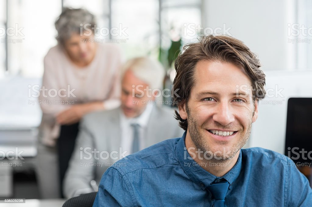 Young business man smiling stock photo