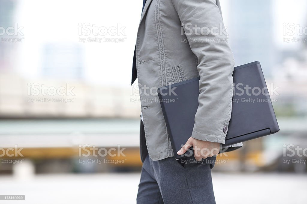 young business man standing with laptop royalty-free stock photo