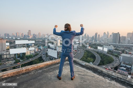 istock young business man success standing and looking at city 951396080