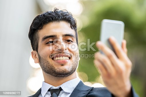 491496340 istock photo Young business man video conferencing 1056936272