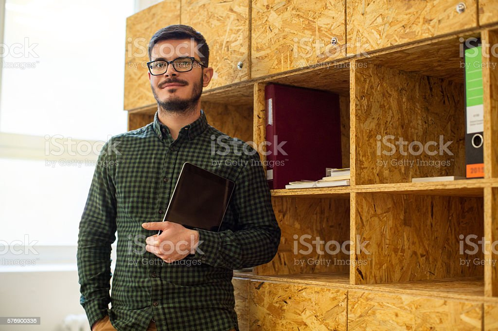 Young business man with digital tablet in office stock photo