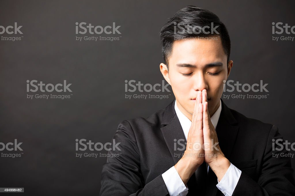 young business man with pray gesture stock photo