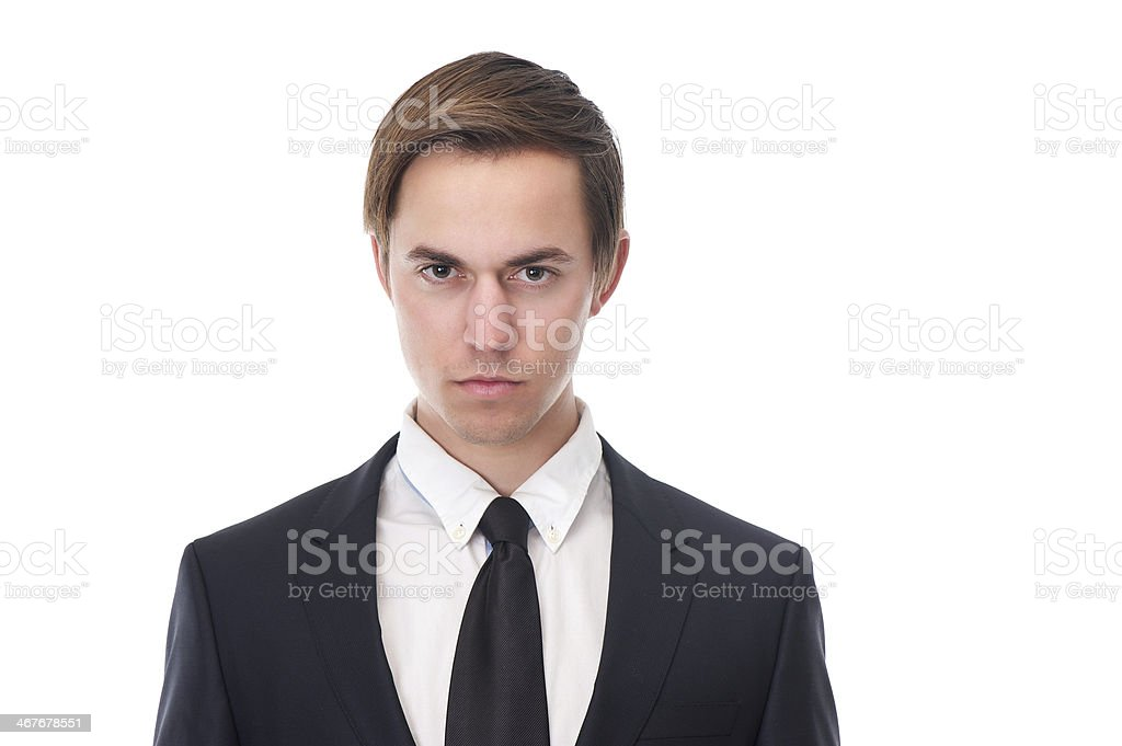Young business man with serious expression on his face royalty-free stock photo