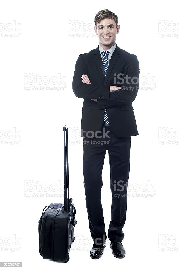 Young business man with trolley bag royalty-free stock photo