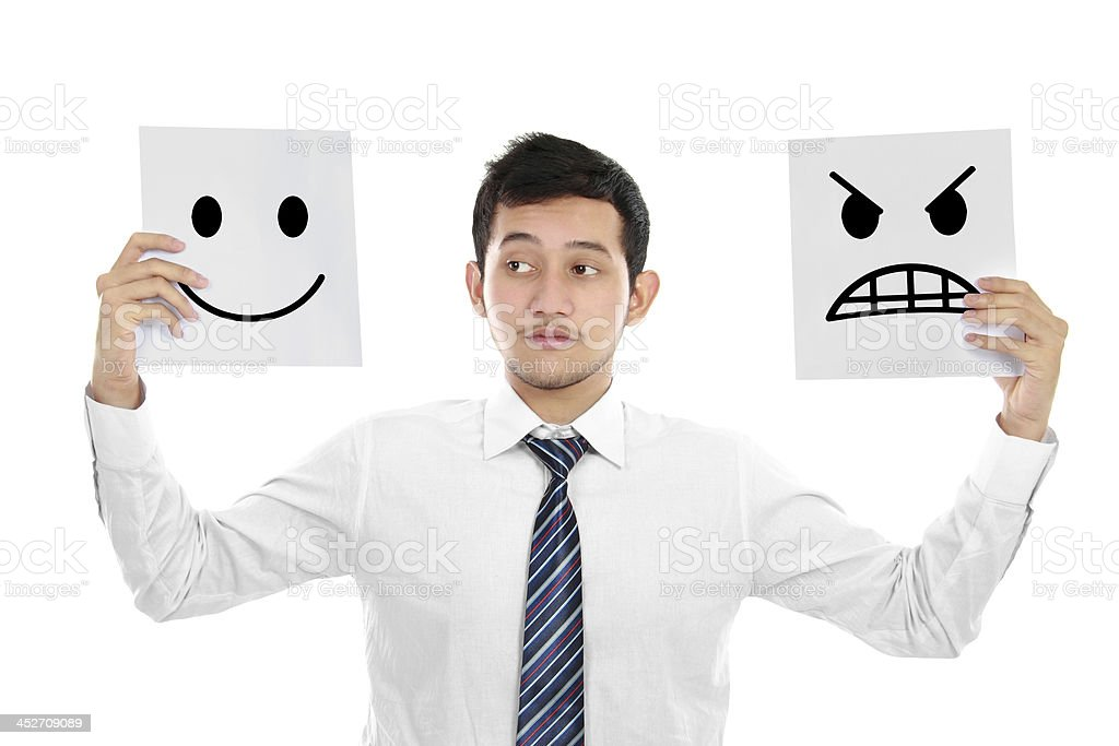A young business man with two emotions royalty-free stock photo