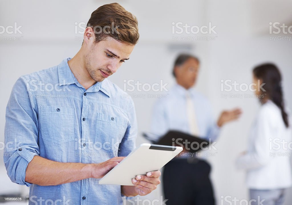 Young business man working on electronic tablet royalty-free stock photo