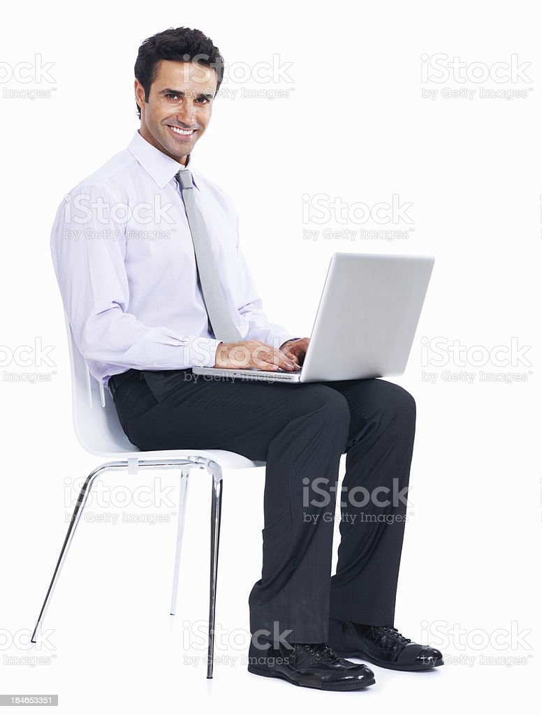 Young business man working on laptop royalty-free stock photo