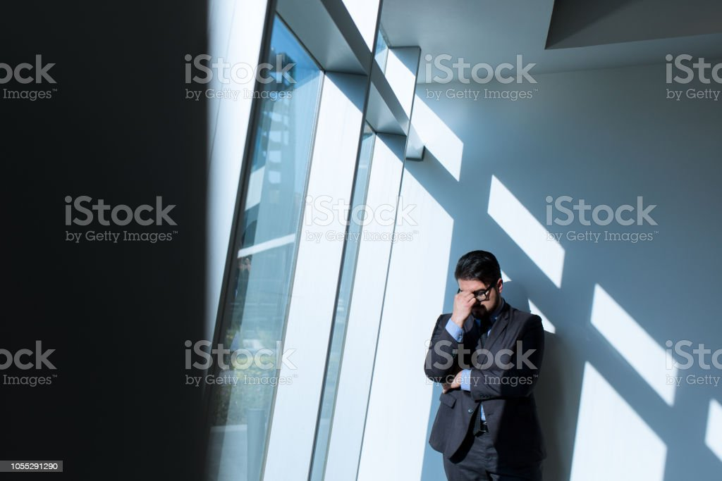 Young business man worried and holding his face stock photo