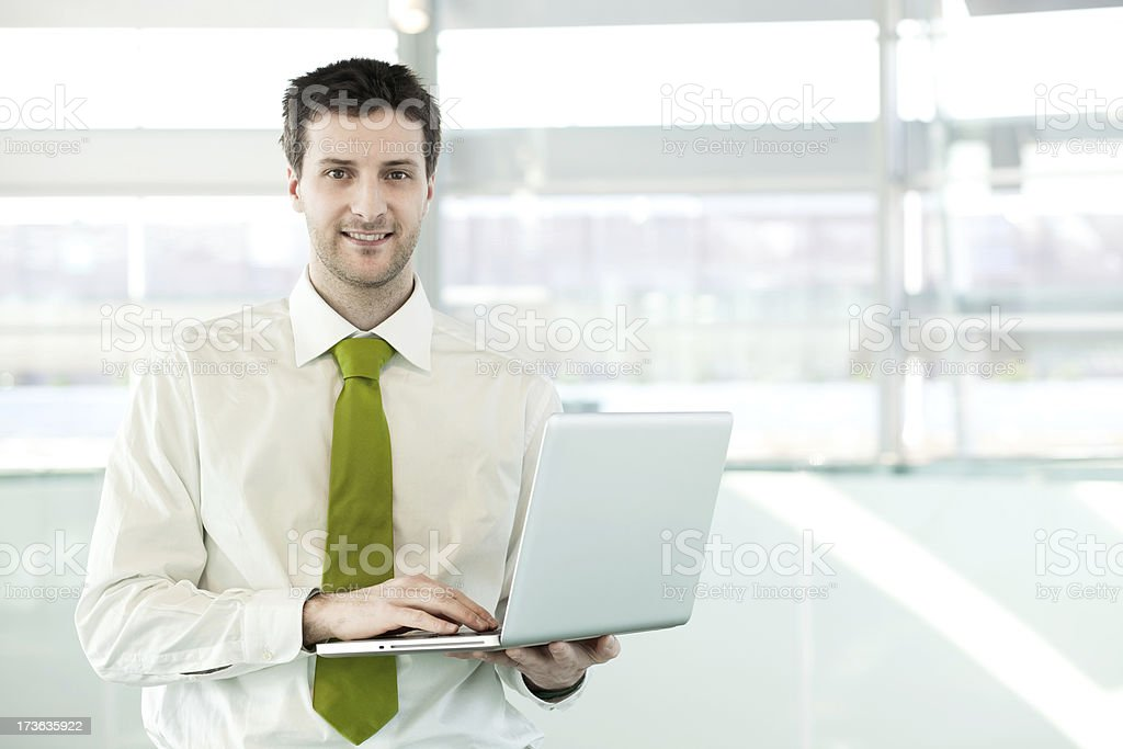 young business manager work at office with laptop royalty-free stock photo