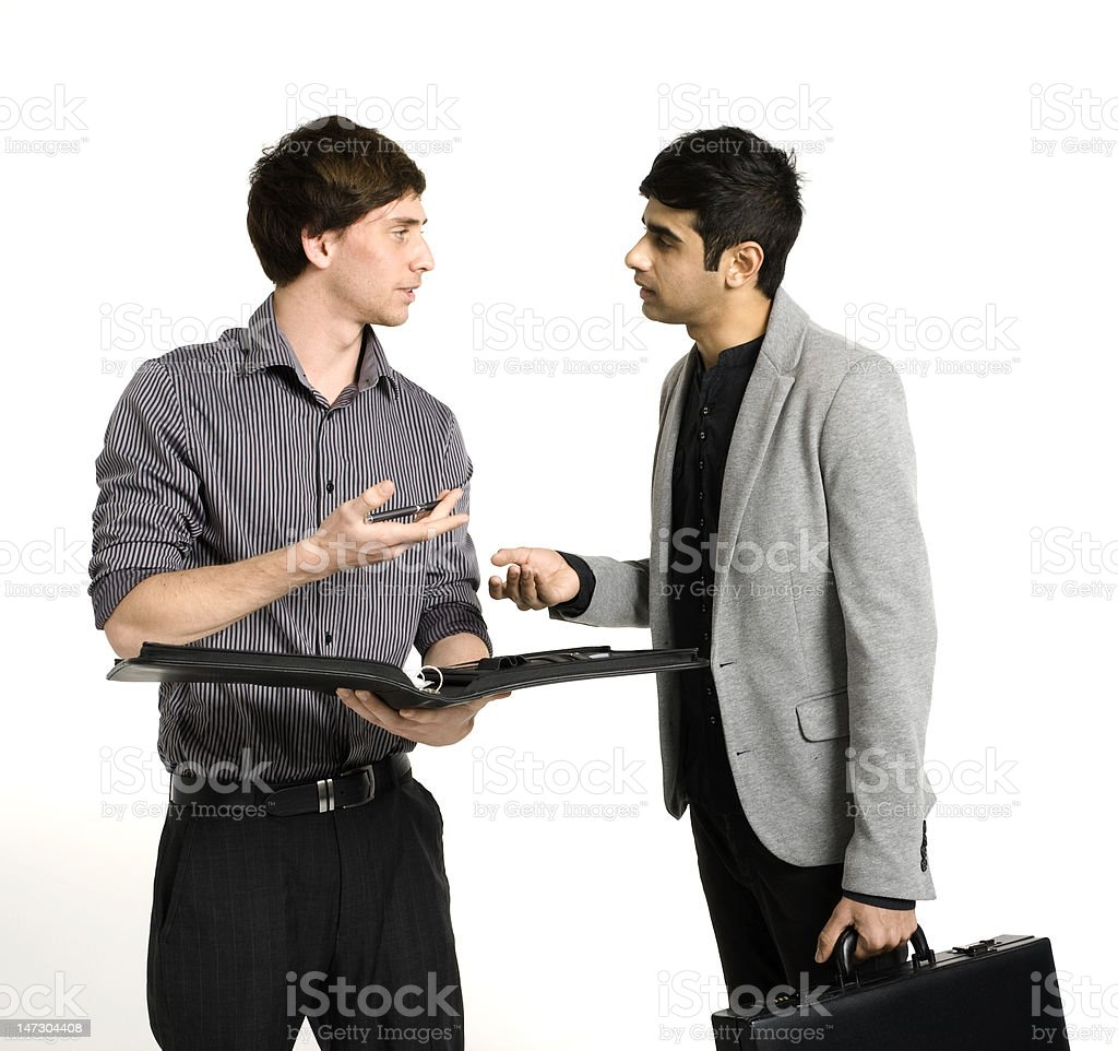 Young Business Men Discussing Work royalty-free stock photo