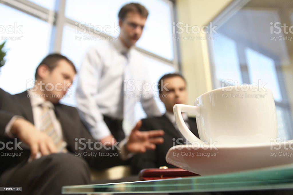 Young business men talking in an office -blur - Royalty-free Adult Stock Photo