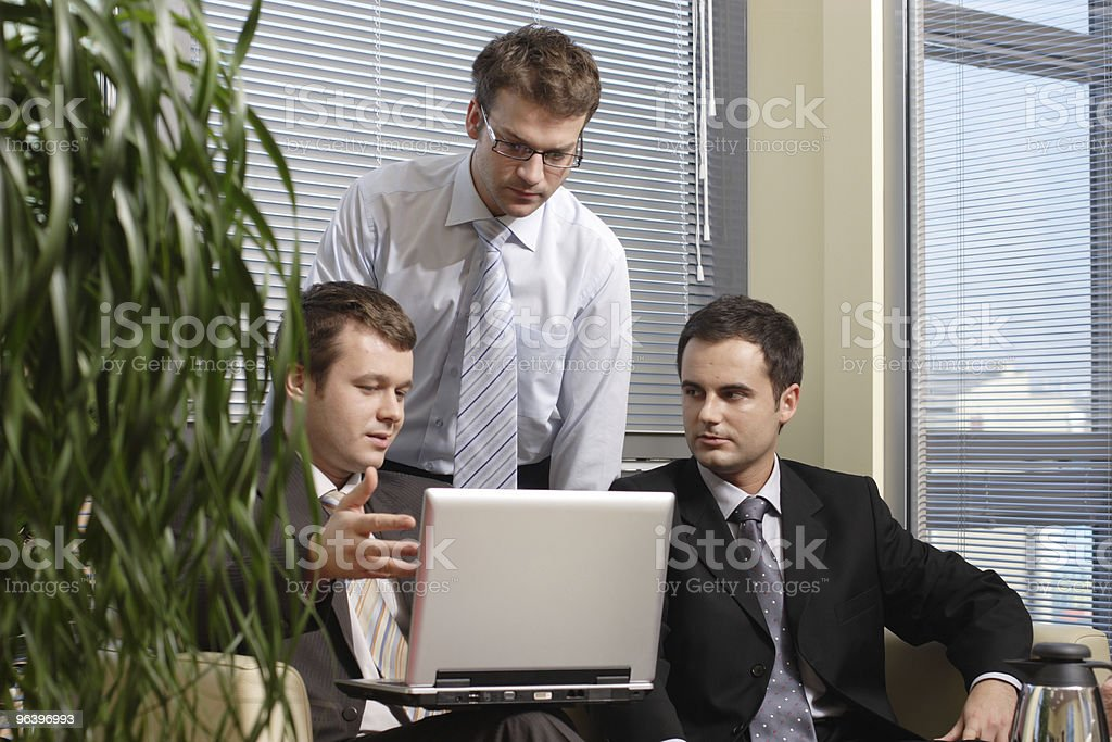 Young business men working with latop in office - Royalty-free Adult Stock Photo