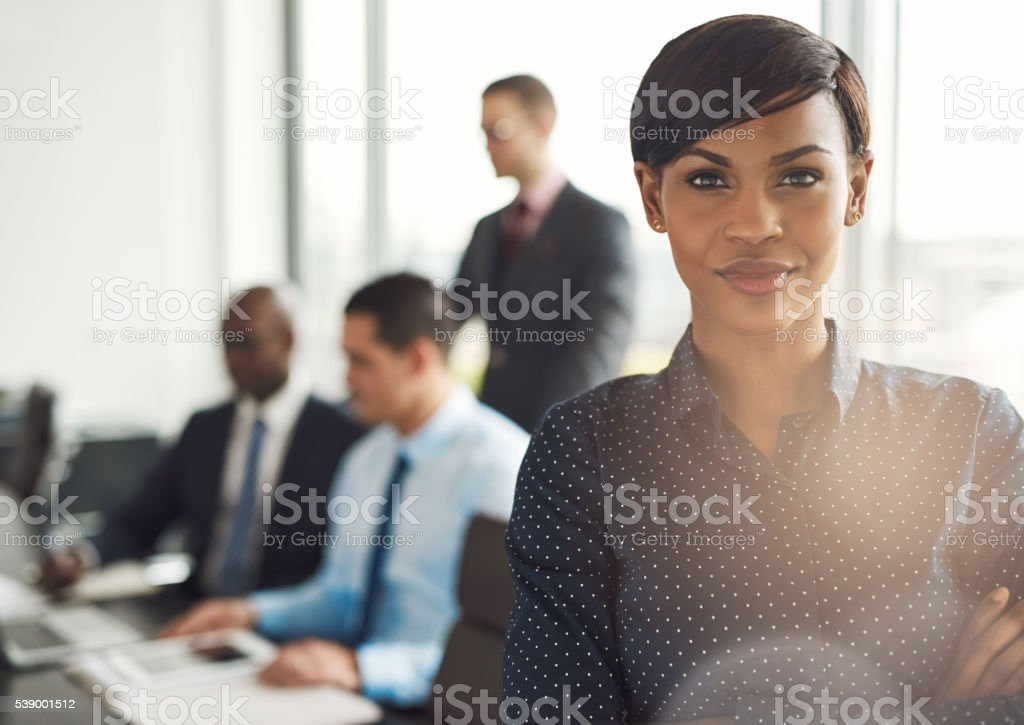 Young business owner in office with employees stock photo