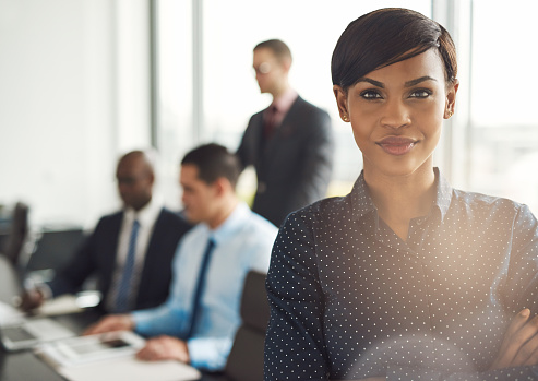 Young Business Owner In Office With Employees Stock Photo - Download Image Now